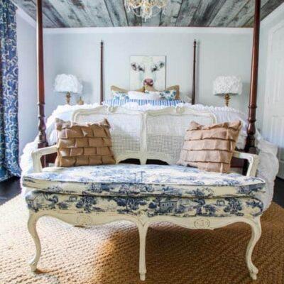 toile settee in farmhouse bedroom