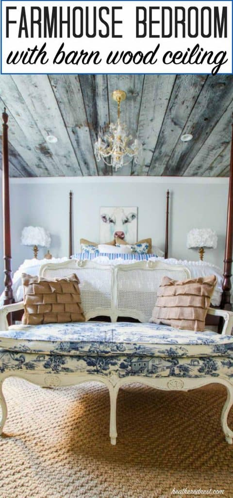 Farmhouse bedroom/guest room at heatherednest.com with toile settee, mini chandelier and reclaimed wood ceiling.