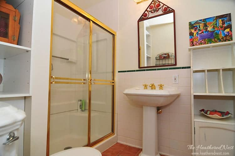 BEFORE bathroom with brass shower enclosure