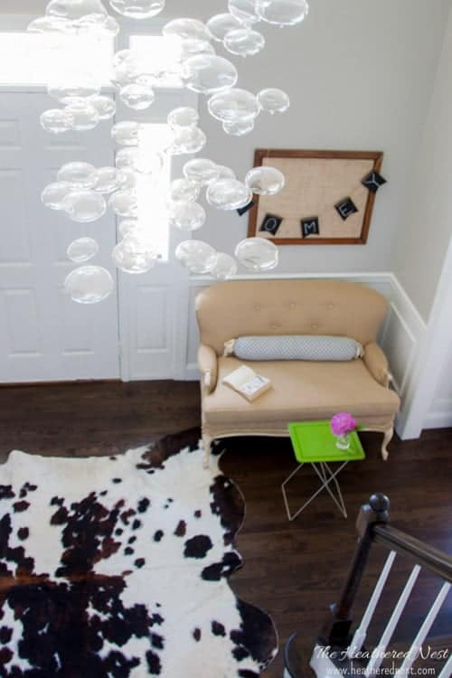 Cowhide rug, glass bubble chandelier foyer makeover at heatherednest.com