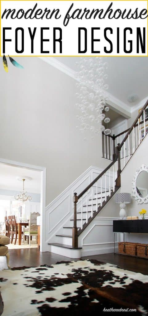 Popular foyer design check out this modern farmhouse foyer with glass bubble chandelier & cowhide rug