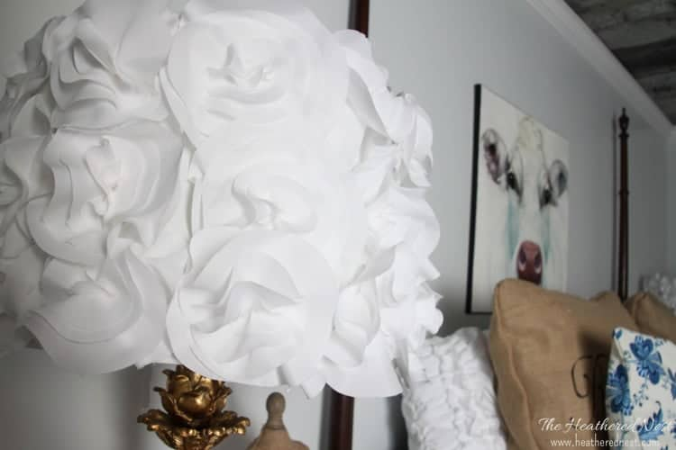 Plain Jane lampshade? Turn it into a stunner with this $5 DIY lampshade with fabric flowers. Full tutorial from www.heatherednest.com