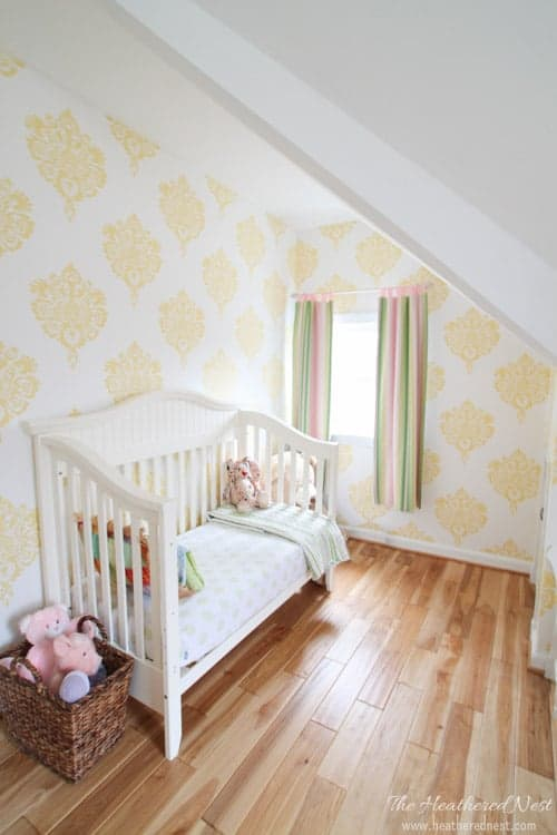 It doesn't have to be ALL PINK to be pretty! Girls room makeover with yellow damask via Heathered Nest.