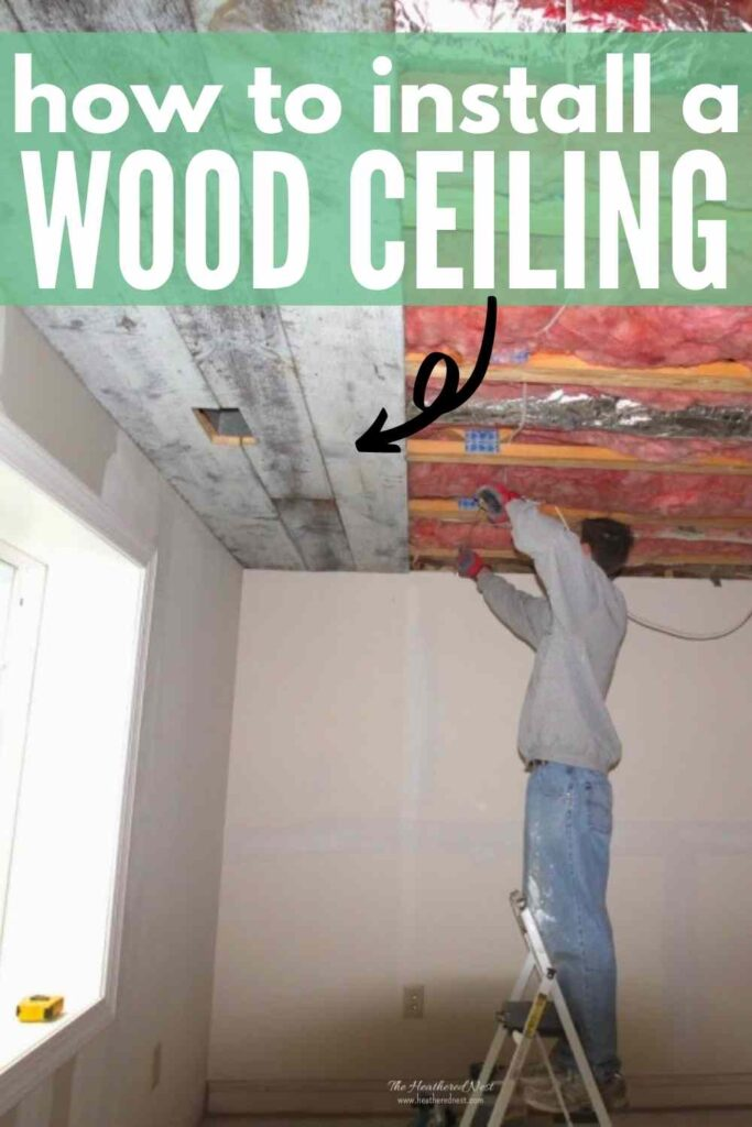 """man on ladder working on a partially completed reclaimed wood ceiling installation. text """"how to install a wood ceiling"""""""