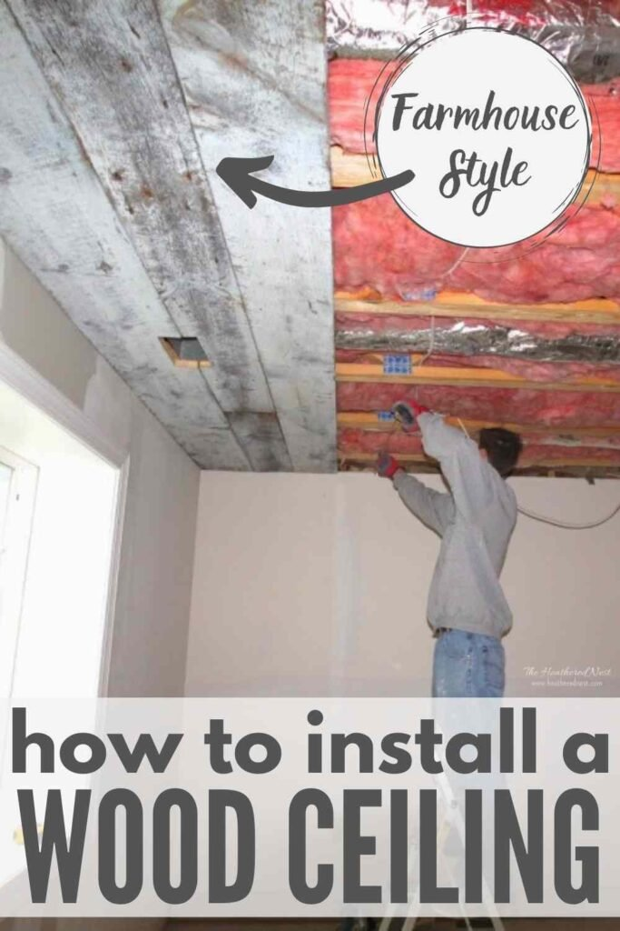 """man on ladder working on a partially completed reclaimed wood ceiling installation. text """"how to install a farmhouse style wood ceiling"""""""