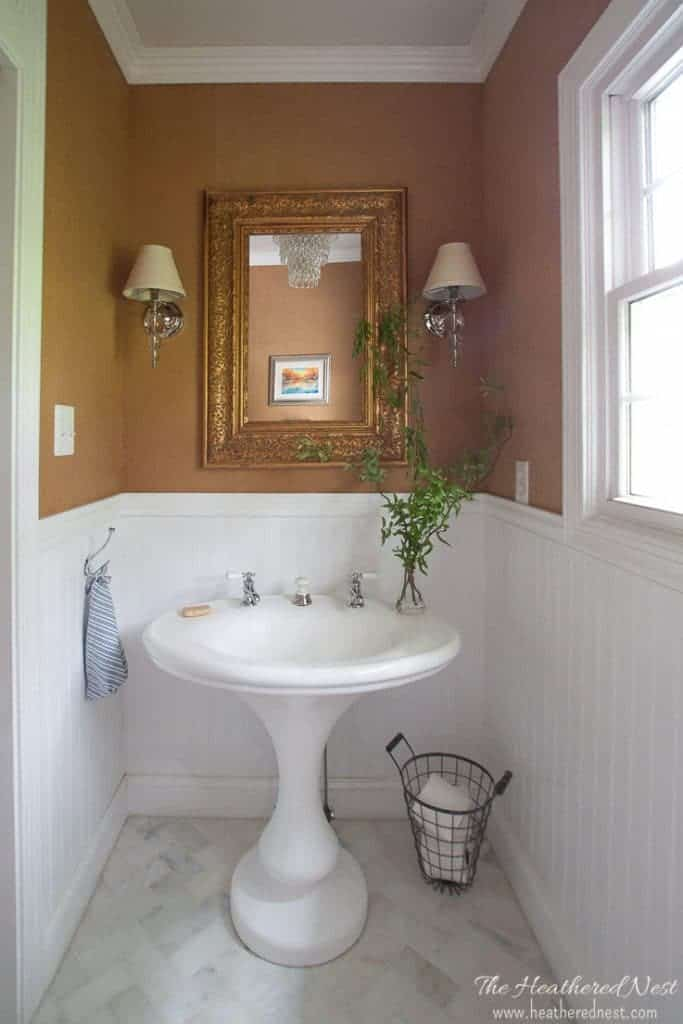 CLASSIC! Love this powder room design with grasscloth wallpaper, herringbone tile & vintage pedestal sink!!