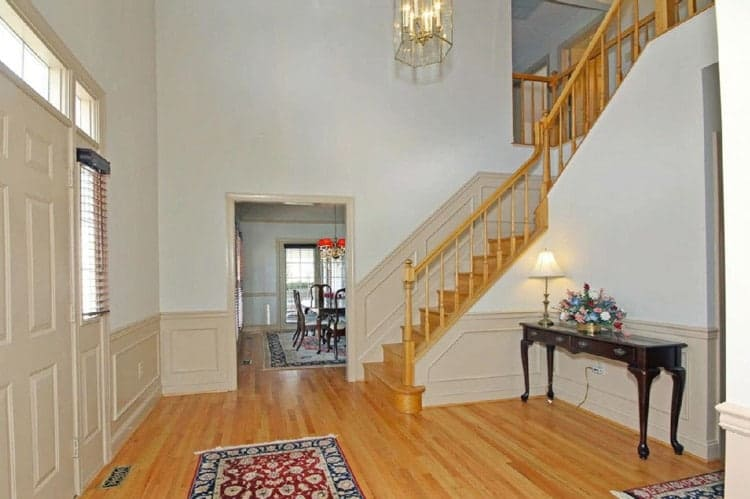 """staircase makeovers from www.heatherednest.com - this is the before shot but the """"after"""" is an amazing stairway and foyer design!"""
