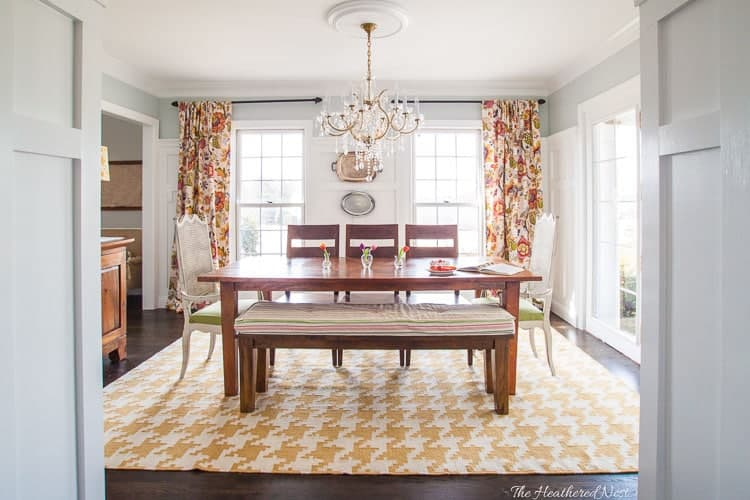 Bright and colorful yellow modern farmhouse dining room makeover with houndstooth rug & toile