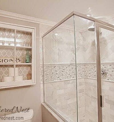 Marble and gray bathroom with window pane medicine cabinet and beadboard ceiling!