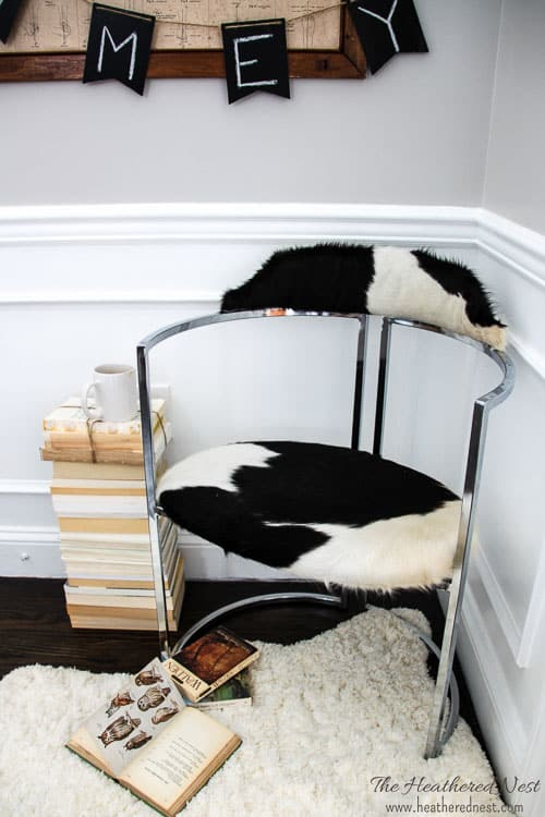 DIY upholstery with cowhide rug, DIY rust removal on this mid-century modern dumpster dive chair from heatherednest.com