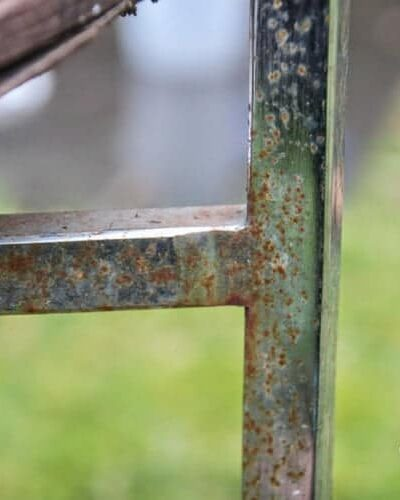 close-up of rusted chrome chair frame