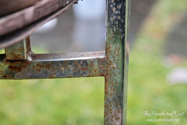 close-up of a vintage chair with rusted chrome frame
