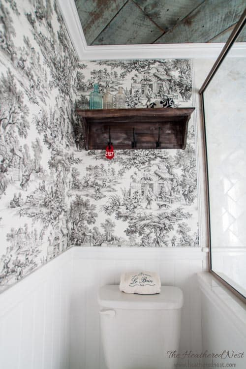 GORGEOUS DIY bathroom/french country bathroom via www.heatherednest.com with toile, barnboard ceiling, vintage door!!