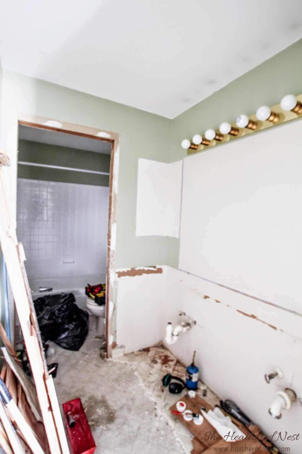 Demolition in progress of a kid's hallway bathroom which is completed for under two-thousand dollars