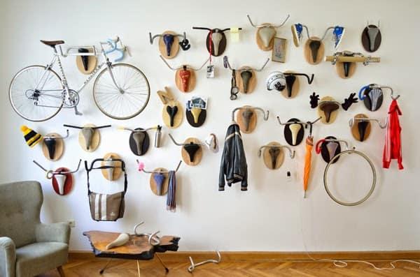 bike seats and handlebars used as wall hooks