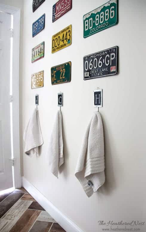 Vintage license plates can make a cool, textured, colorful gallery wall as seen in this kids' DIY bathroom renovation