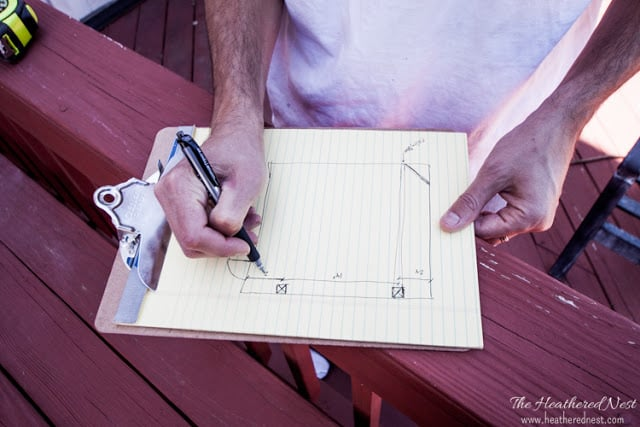 Deck Demolition and Remodel on a Budget from the Heathered Nest. drawing plan on paper for pergola