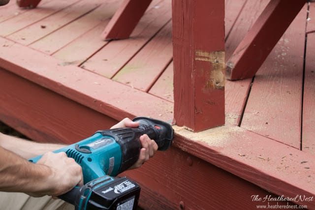 using sawzall to demolish old deck railing