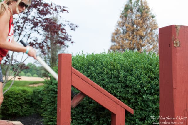 using sledgehammer to demolish old deck railing