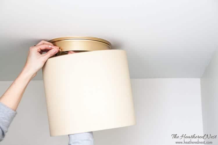 "installing drum shade on a builder-grade \""boob light\"" ceiling fixture"