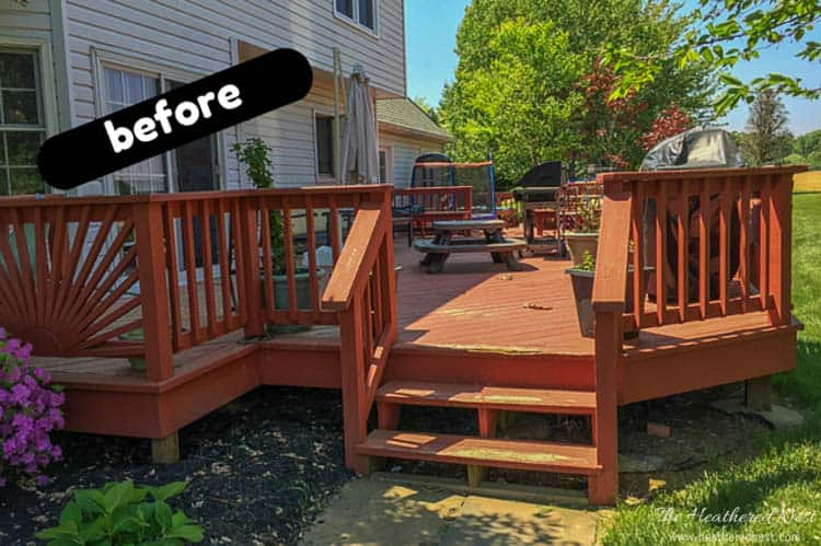 outdoor deck BEFORE picture with red decking, railings