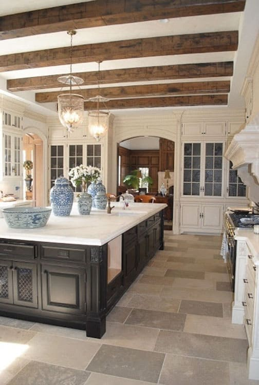 rustic elegant kitchen with multiple wood beams, high ceiling and large center island
