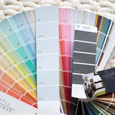 two fans of paint chips with paint sheen cards in center