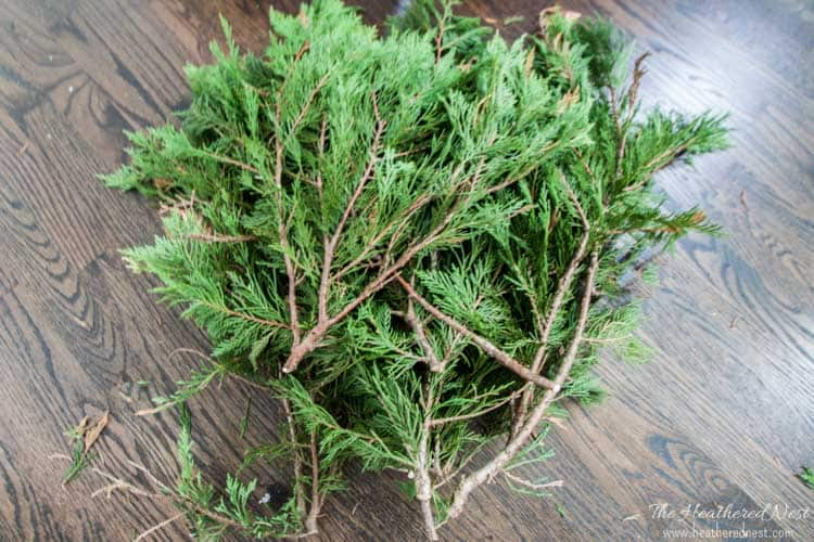spruce up your fake christmas tree with real pine branches its free