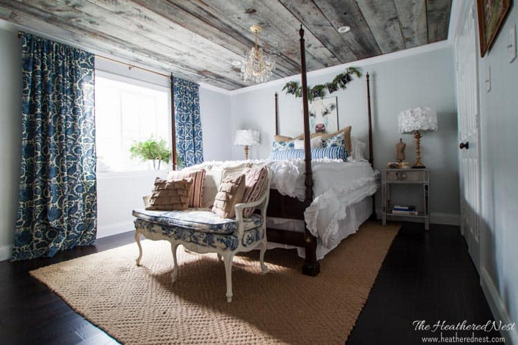 modern country guest bedroom with cow portrait and pine swag for holiday home tour
