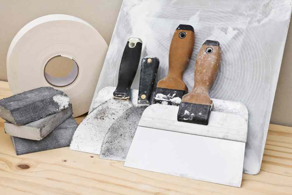 typical sheetrock/drywalling supplies including paper tape, sanding sponges, mudding knives