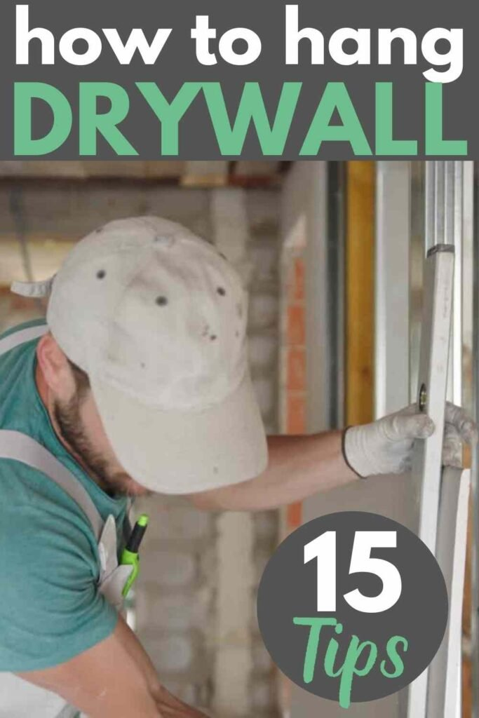 man in overalls measuring to install drywall. text: how to hang drywall - 15 tips