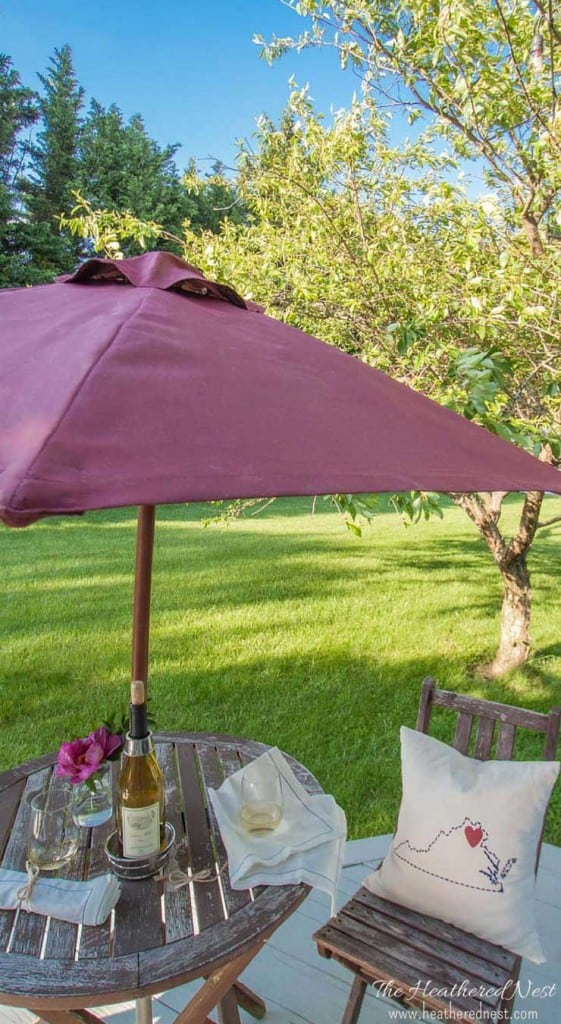 painted patio umbrella and small outdoor table