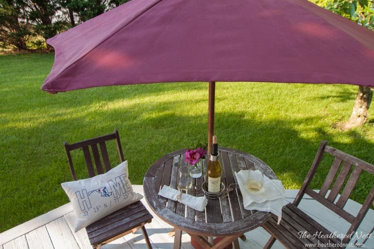 my painted patio umbrella open with a table and chairs underneath