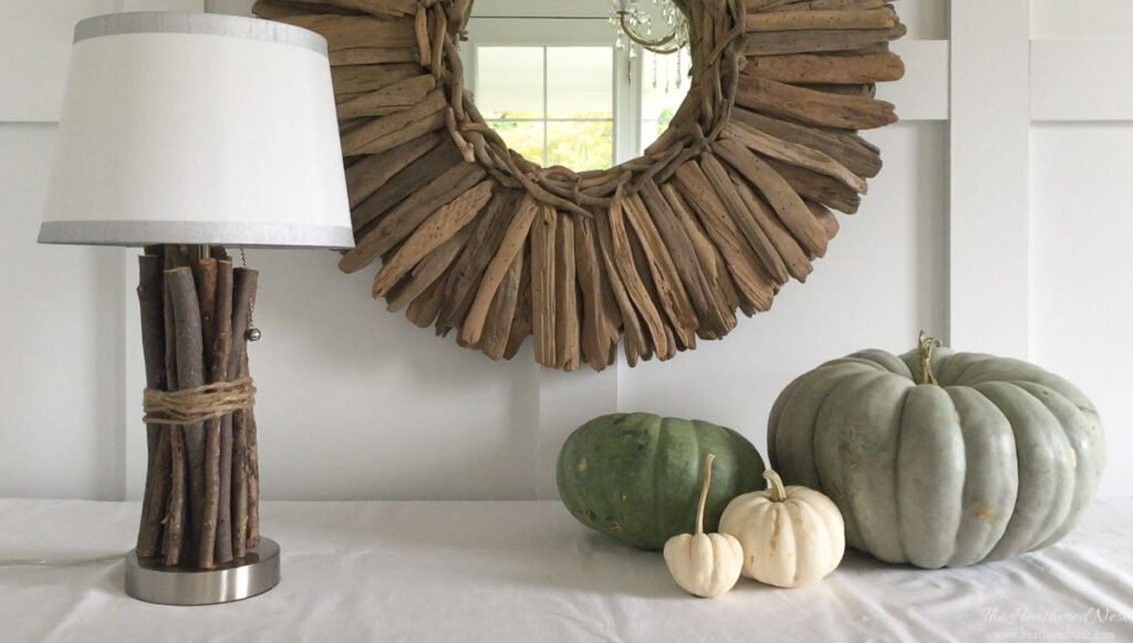 Showing completed Wood Twig Rustic DIY Lamp on table with several pumpkins