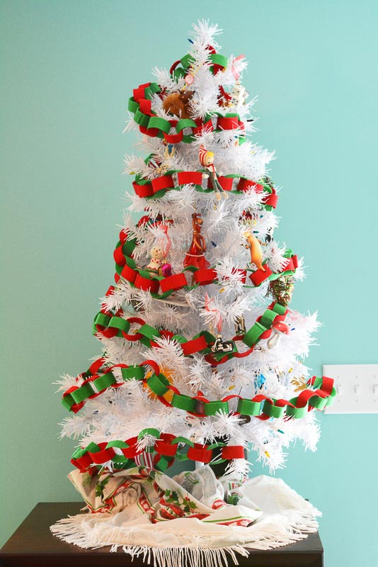 white christmas tree decorated with red and green paper chain garland