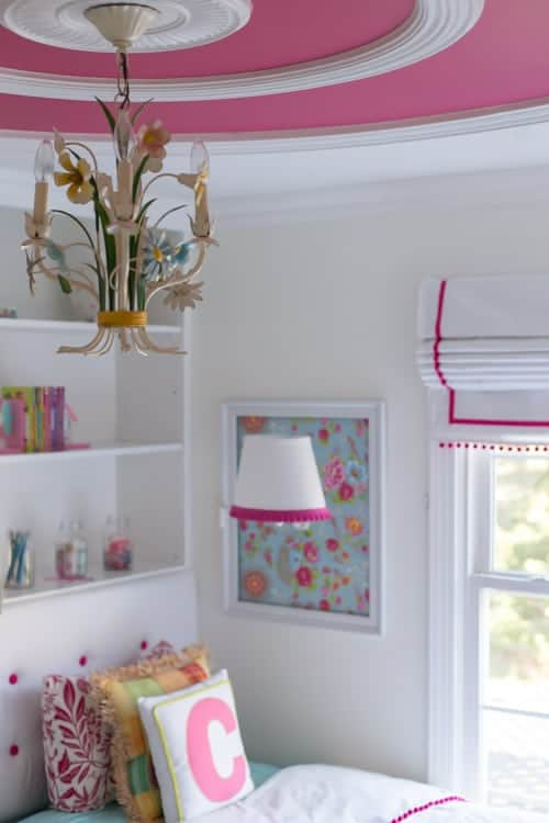 Italian floral tole chandelier inside pink ceiling accent with ceiling rings in a girls' bedroom