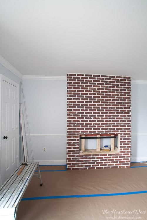 Bedroom with red brick faux fireplace added