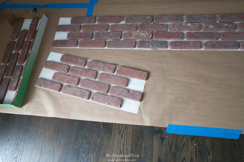 Brick tiles used for our faux fireplace project seen laid on ground being arranged for project. They are thinner and lighter than regular brick, but are true brick material.