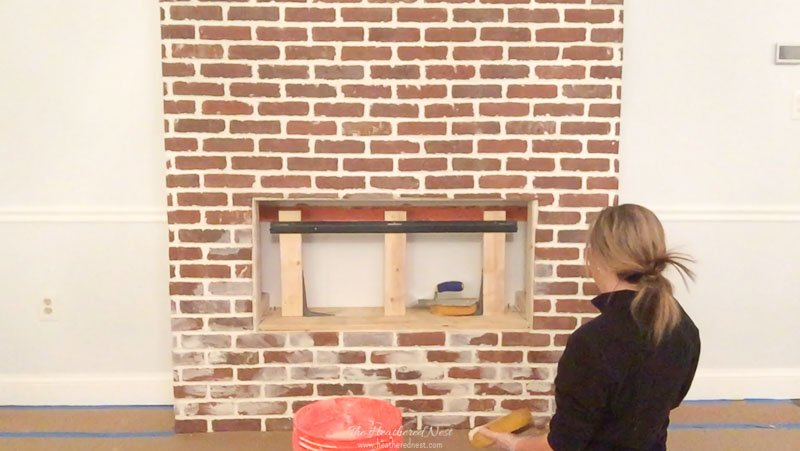 Take frequent breaks to look and step back from your brick wall or fireplace while you're completing your German smear project to get a better look at whether you're liking the amount of coverage, and to see any spots you missed or that need more mortar.