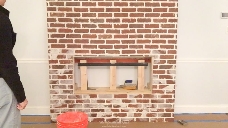 Beginning stage of the DIY german smear / mortar wash on our brick fireplace. I started at the bottom and worked upward.