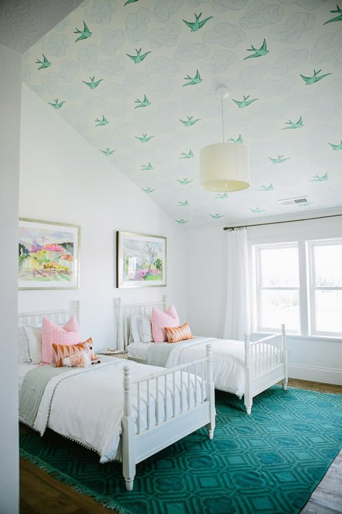 Such a sweet idea for a girls room! Love the twin beds and the bird wallpaper! It's such a cozy sleeping nook.
