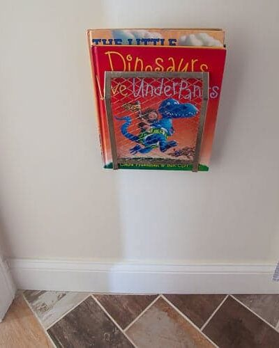 DIY wall mounted magazine rack for less than $5
