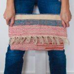DIY clutch carpet bag from a $2 rug
