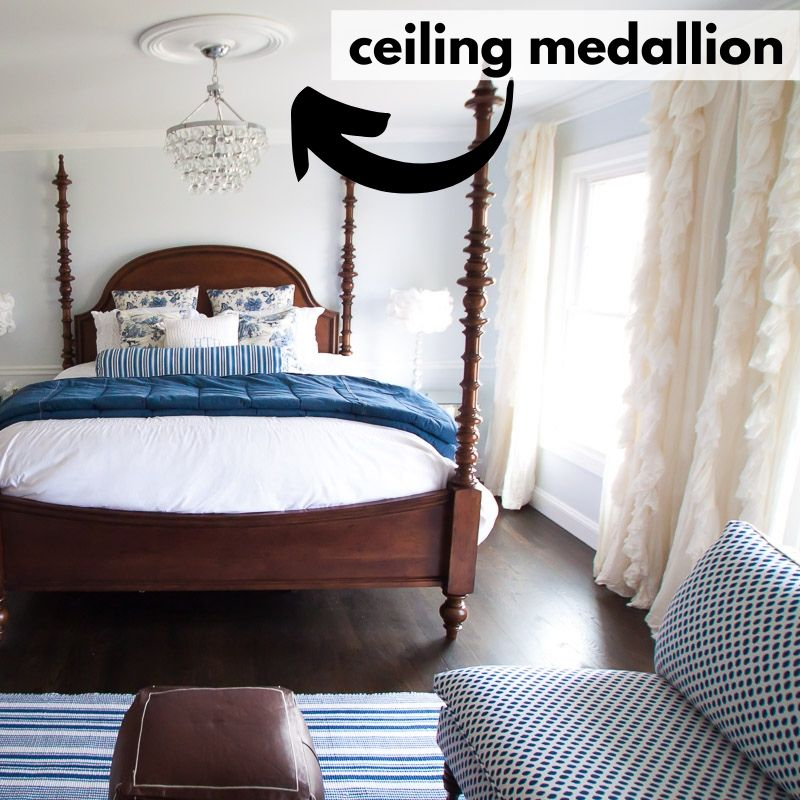 ceiling medallion in a bedroom shown over four poster bed