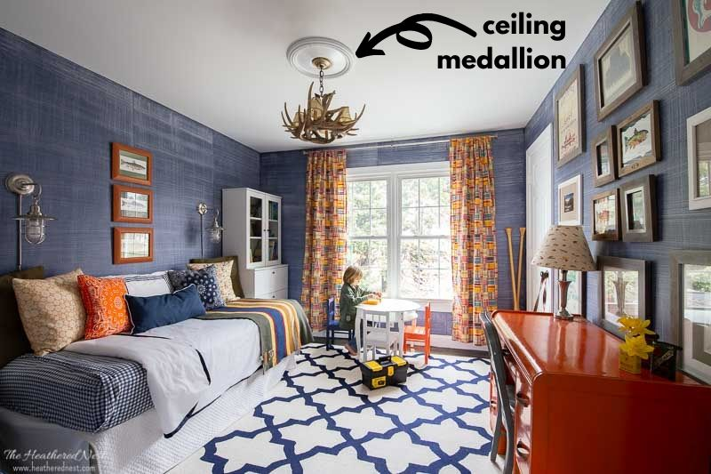 ceiling medallion in boys bedroom over a faux antler chandelier