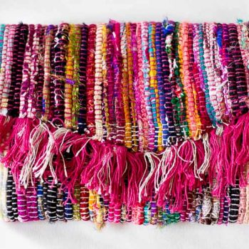 I am in LOVE with this colorful, summer DIY fringe purse! She made it from a rag rug!!! These are so popular right now. The pattern is a FREE download for subscribers.