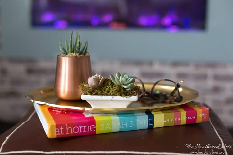 Simple succulents in a sushi dish and moscow mule mug!! So cute. ALL SOURCES linked in this gorgeous Coastal Country Blue Bedroom makeover!!! So pretty and lots of popular DIY features. Love that faux fireplace :) :)