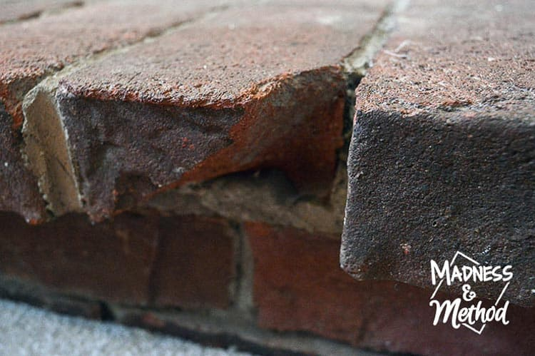 close-up of red brick with large chip