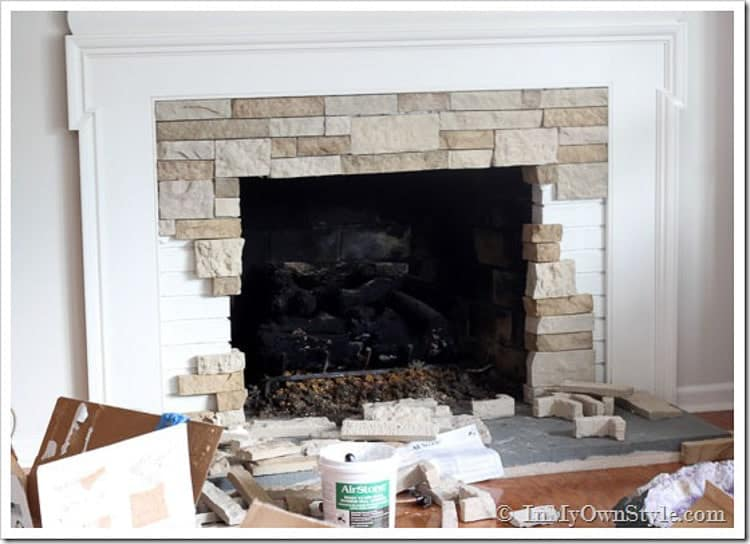 brick update ideas: install a faux stone over your old brick