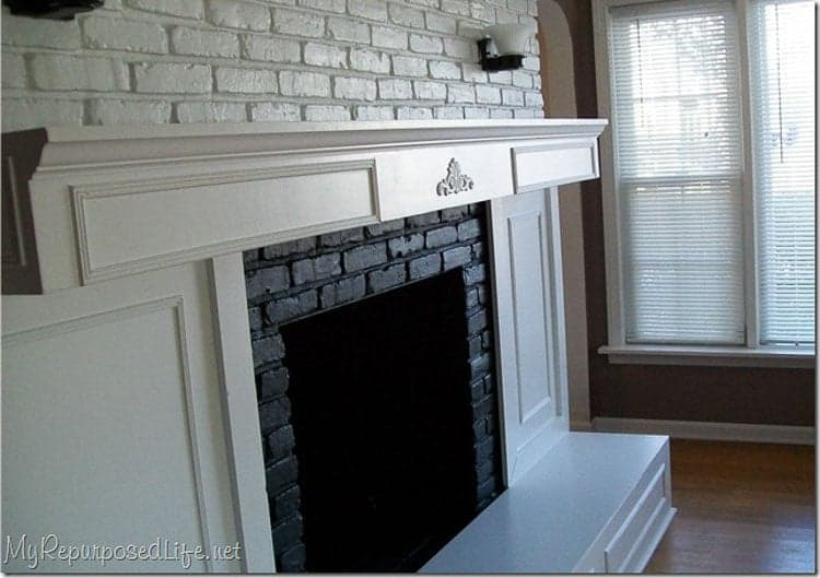 using white molding to update the fireplace surround of a dated brick fireplace